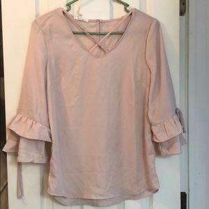 Maurice's blush pink dress shirt.